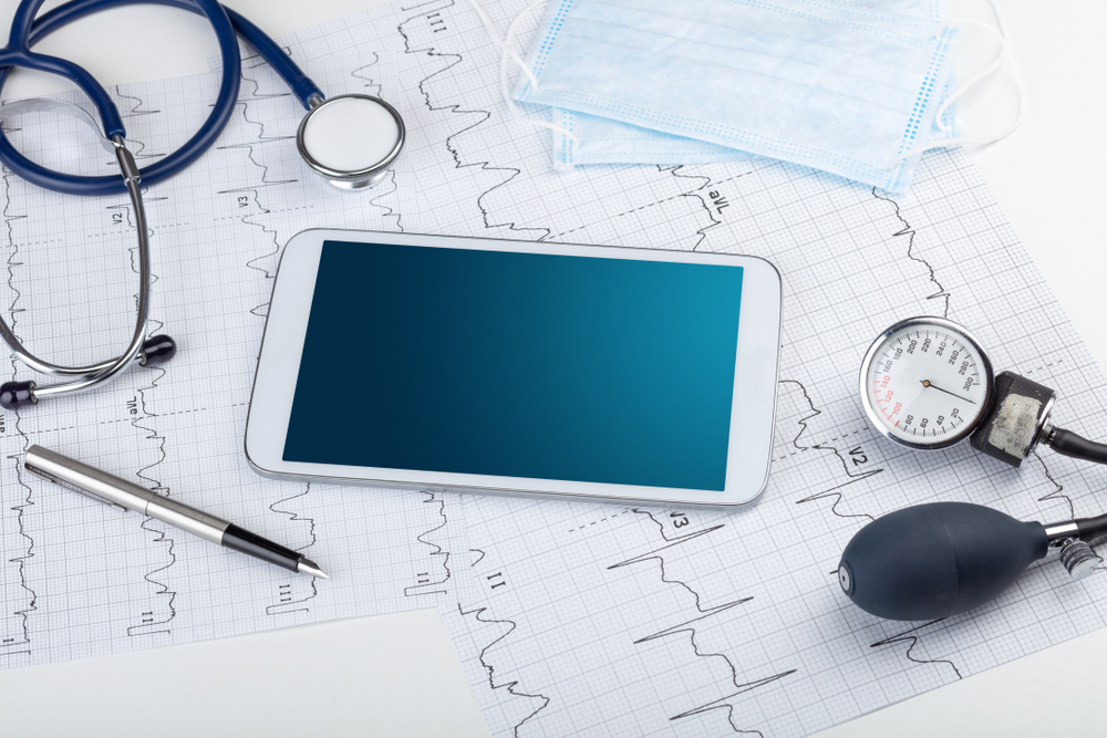 Medicine and modern technology concept with diagnostics concept with free space on tablet screen
