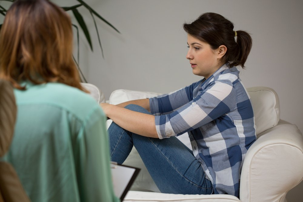 Young women at visit at her psychotherapist